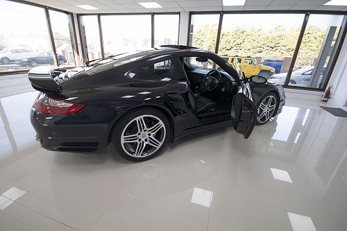 Black Porsche 911 turbo side view door open