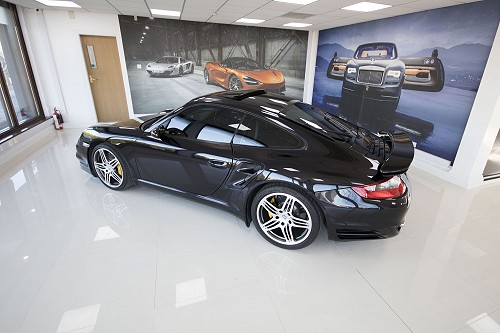 Black Porsche 911 turbo side view 1