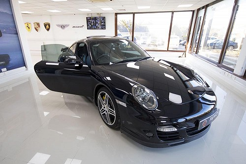 Black Porsche 911 turbo with door open